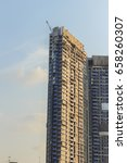 Small photo of Large scale condominium construction site with the luffing jib tower crane, new hi-rise buildings growing up into the sky in a densely populated city of Bangkok, Thailand.