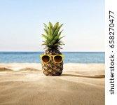 pineapple beach concept | Shutterstock . vector #658270477