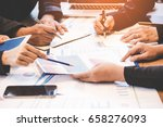 Small photo of Business partners discussing and planning resource graph of financial. Business concept