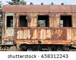 Old Rusty Cars Standing In The...