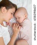mother and baby newborn sleep... | Shutterstock . vector #658398607