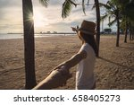 young woman holding man's hand... | Shutterstock . vector #658405273