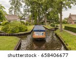 tourist canal boat at the... | Shutterstock . vector #658406677