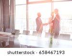 businessmen shaking hands by...   Shutterstock . vector #658467193