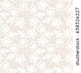 seamless beige lace background... | Shutterstock .eps vector #658526227