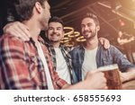 men in bar | Shutterstock . vector #658555693