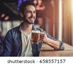 handsome young man is drinking...   Shutterstock . vector #658557157