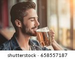 handsome young man is drinking... | Shutterstock . vector #658557187