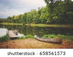 dock and canoe on serene north... | Shutterstock . vector #658561573