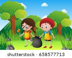 two kids picking garbage in the ... | Shutterstock .eps vector #658577713