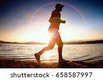 running man in sun rays on... | Shutterstock . vector #658587997