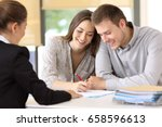 happy couple signing a contract ... | Shutterstock . vector #658596613
