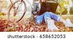urban girl with laptop in park. ... | Shutterstock . vector #658652053