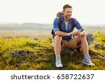 man resting during hiking trip... | Shutterstock . vector #658722637