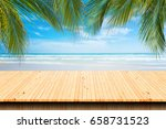 empty wooden table and palm... | Shutterstock . vector #658731523