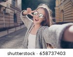 carefree and happy  sunny... | Shutterstock . vector #658737403