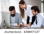 team of three business people... | Shutterstock . vector #658847137