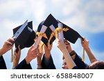 graduation caps thrown in the... | Shutterstock . vector #658848007