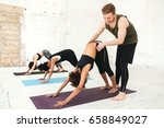 male yoga trainer helping a... | Shutterstock . vector #658849027