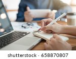 young hipster worker writing on ... | Shutterstock . vector #658870807