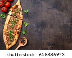 traditional turkish baked dish... | Shutterstock . vector #658886923
