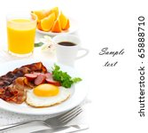 Breakfast with bacon, fried egg and orange juice on white isolated background(With sample text) - stock photo