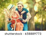 portrait of happy young couple... | Shutterstock . vector #658889773