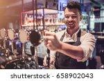 cheerful bartender on a bar...   Shutterstock . vector #658902043