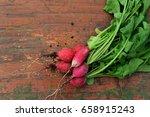 bundle of red radish over... | Shutterstock . vector #658915243