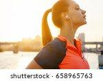 woman jogger runs over sunset... | Shutterstock . vector #658965763