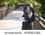 happy girl reading a book at... | Shutterstock . vector #659001283