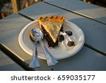a slice of blueberry pie with... | Shutterstock . vector #659035177