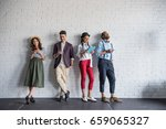 young stylish friends using... | Shutterstock . vector #659065327