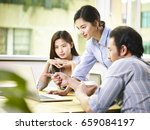a team of young asian corporate ...   Shutterstock . vector #659084197