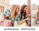 two smiling shopaholic women...   Shutterstock . vector #659111533