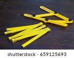 yelow foldable carpenter's ... | Shutterstock . vector #659125693