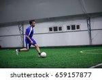 man playing football indoor | Shutterstock . vector #659157877