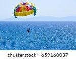 Tourists Parasailing On Aegean...