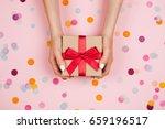 woman hands holding present box ... | Shutterstock . vector #659196517