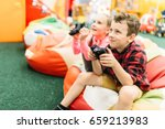 kids play in a games console ... | Shutterstock . vector #659213983