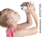 a young girl holding a hedgehog ... | Shutterstock . vector #659227183