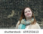young woman with down syndrome | Shutterstock . vector #659253613