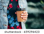 female hand with paper cup of... | Shutterstock . vector #659296423