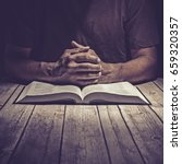 man studying the holy bible on... | Shutterstock . vector #659320357