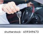 handsome man show car key at... | Shutterstock . vector #659349673