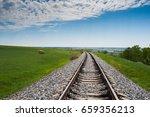 railway in a field under the... | Shutterstock . vector #659356213