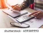people calculate about cost at... | Shutterstock . vector #659389993