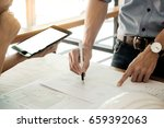 two architects engineer... | Shutterstock . vector #659392063