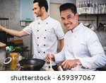 chef preparing food in the... | Shutterstock . vector #659397067