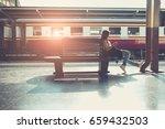 woman sitting waiting railway... | Shutterstock . vector #659432503
